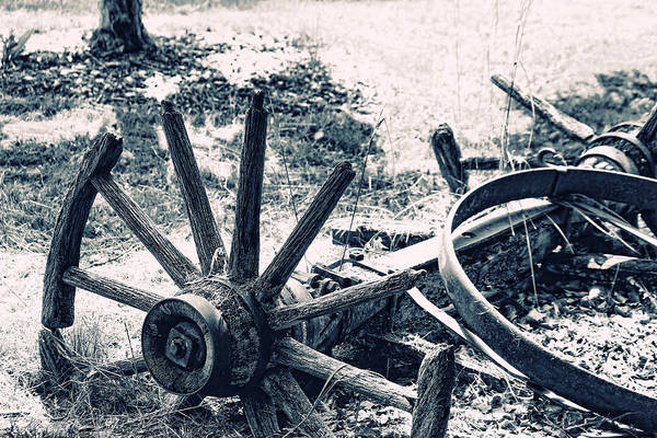 Wagon Wheel Poster featuring the photograph Weathered Wagon Wheel Broken Down by Tracie Kaska