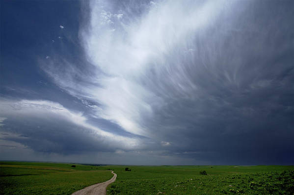 Outdoors Poster featuring the photograph An Afternoon Thunderstorm Coming by Jim Richardson