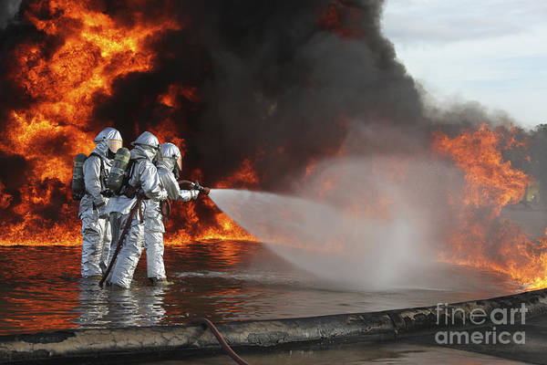 Military Poster featuring the photograph Firefighting Marines Battle A Huge by Stocktrek Images