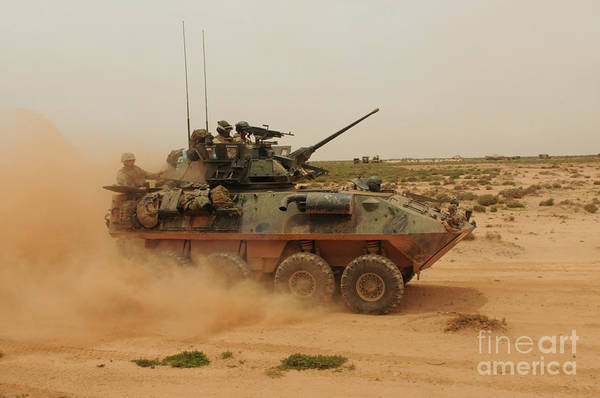 Dust Poster featuring the photograph A Marine Corps Light Armored Vehicle by Stocktrek Images