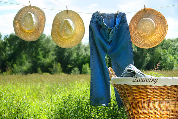 Air Poster featuring the photograph Blue Jeans And Straw Hats On Clothesline by Sandra Cunningham