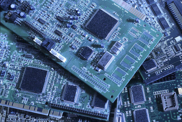 Computers Poster featuring the photograph Computer Boards And Chips Lie In A Pile by Taylor S. Kennedy