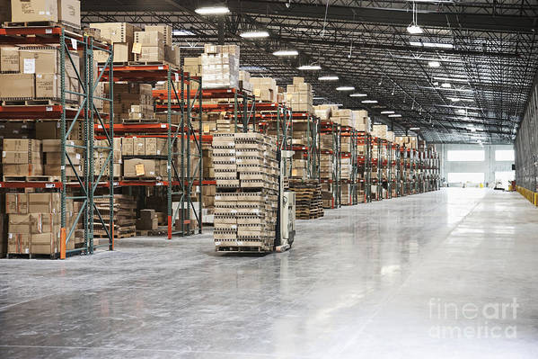 Architecture Poster featuring the photograph Forklift Moving Product In A Warehouse by Jetta Productions, Inc