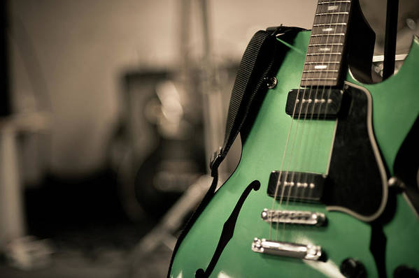 Horizontal Poster featuring the photograph Green Electric Guitar With Blurry Background by Sean Molin - www.seanmolin.com