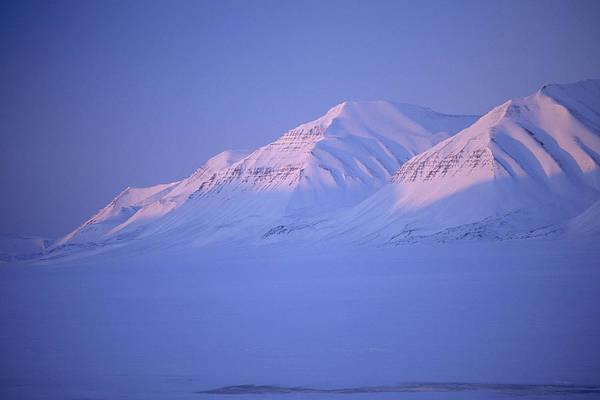 Spitsbergen Poster featuring the photograph Midnight Sunset On Polar Mountains by Gordon Wiltsie
