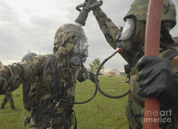 Adults Only Poster featuring the photograph U.s. Air Force Soldier Decontaminates by Stocktrek Images