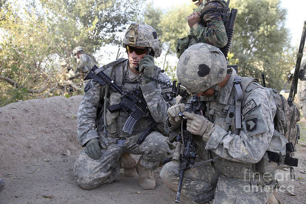Transmitting Poster featuring the photograph U.s. Army Soldier Radios In His Teams by Stocktrek Images