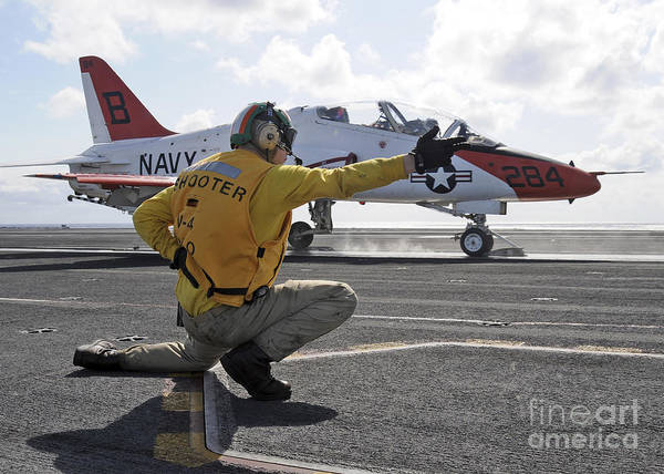 Motioning Poster featuring the photograph A Shooter Launches A T-45 Goshawk by Stocktrek Images