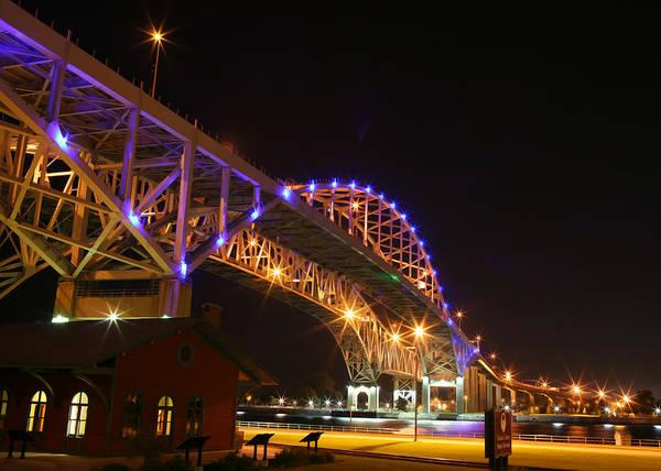 Bluw Water Bridge Poster featuring the digital art Blue Water Bridge At Night by Paul Bartoszek