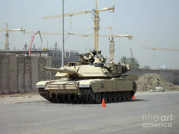 Baghdad Poster featuring the photograph A M1 Abram Sits Out Front Of The New by Terry Moore