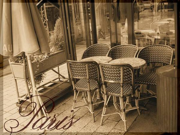Tourist Poster featuring the photograph A Parisian Sidewalk Cafe In Sepia by Jennifer Holcombe