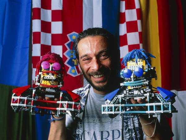 Robot Football Poster featuring the photograph Technician With Lego Footballers At Robocup-98 by Volker Steger