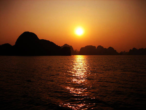Orange Poster featuring the photograph Ha Long Bay Sunset by Oliver Johnston