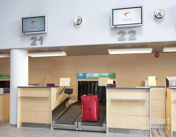 Air Travel Poster featuring the photograph Luggage At An Airline Check-in Counter by Jaak Nilson
