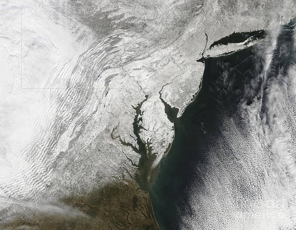 Blizzard Poster featuring the photograph A Severe Winter Storm Along The United by Stocktrek Images