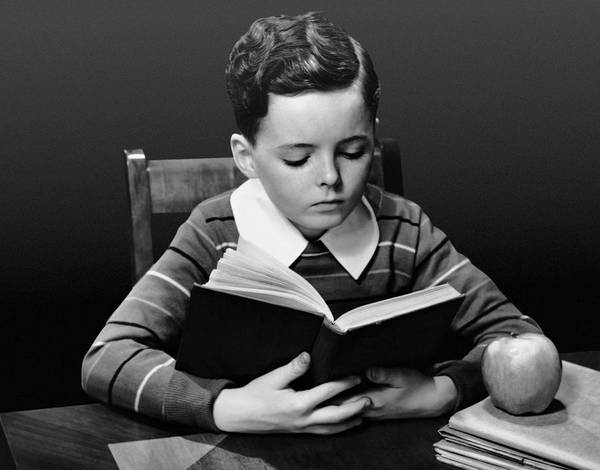 Child Poster featuring the photograph Boy Reading Book At Desk by George Marks