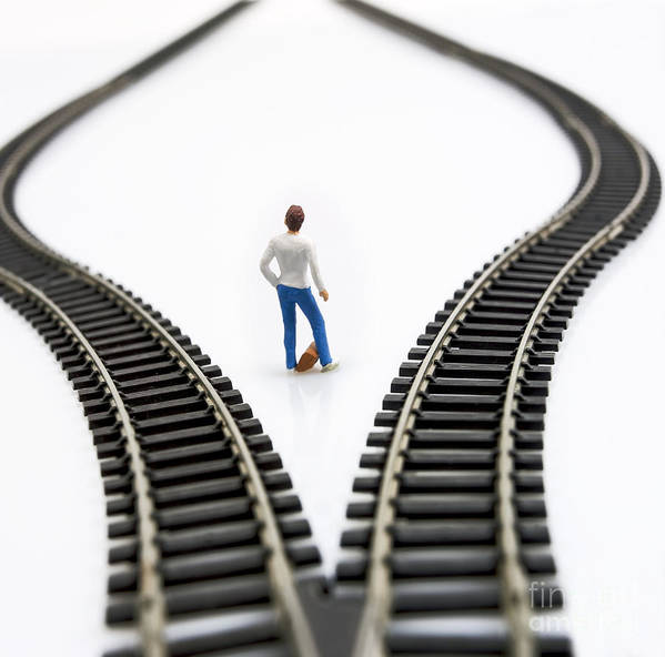 Ponder Poster featuring the photograph Figurine Between Two Tracks Leading Into Different Directions Symbolic Image For Making Decisions. by Bernard Jaubert