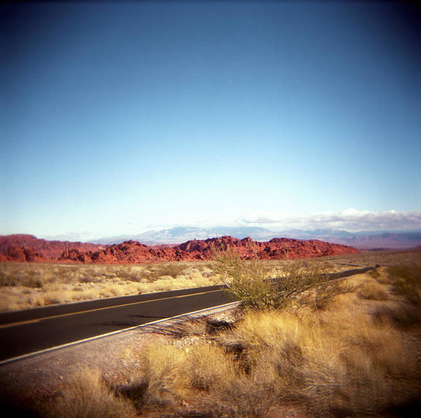 Horizontal Poster featuring the photograph Entering The Valley Of Fire by Lori Andrews
