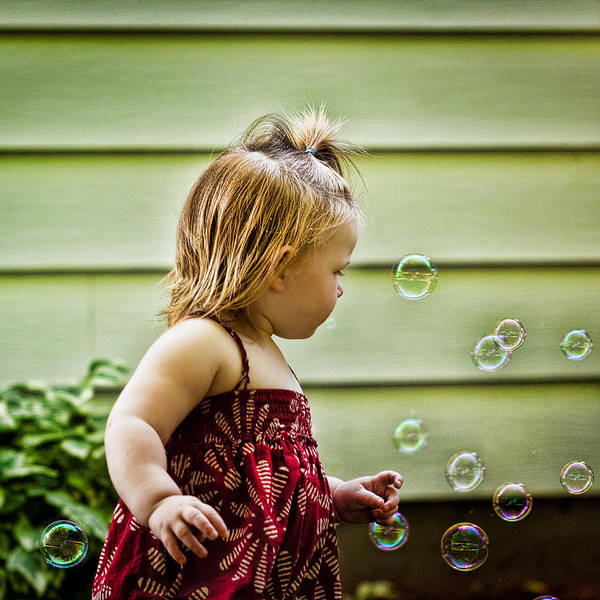 Girl Poster featuring the photograph Chasing Bubbles by Matt Dobson