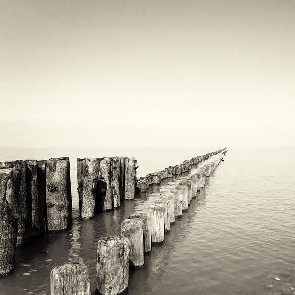 Breakwater Poster featuring the photograph Breakwaters by Wim Lanclus