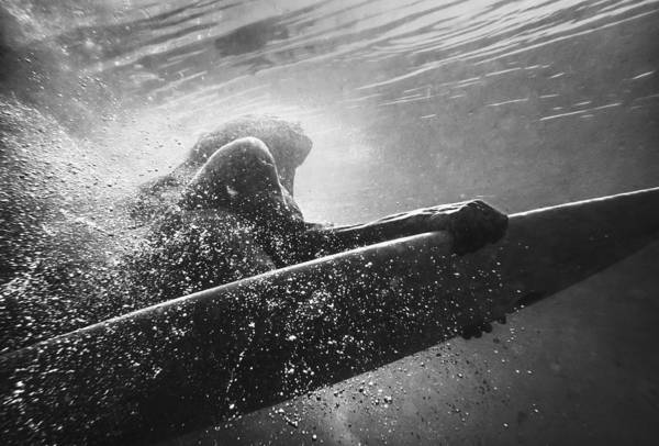 Underwater Poster featuring the photograph A Woman On A Surfboard Under The Water by Ben Welsh