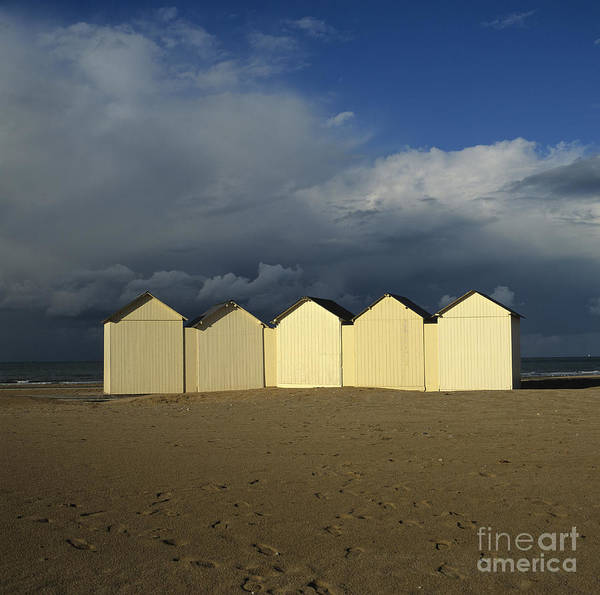 Wooden Poster featuring the photograph Beach Huts Under A Stormy Sky In Normandy by Bernard Jaubert