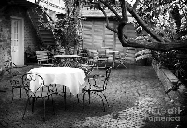 Courtyard Seating Poster featuring the photograph Courtyard Seating by John Rizzuto