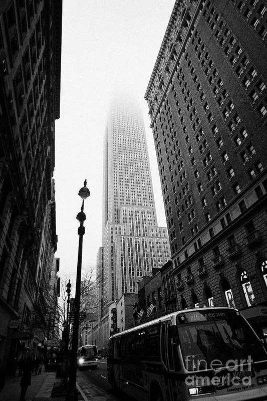 Usa Poster featuring the photograph Empire State Building Shrouded In Mist And Nyc Bus Taken From 34th And Broadway Nyc New York City by Joe Fox