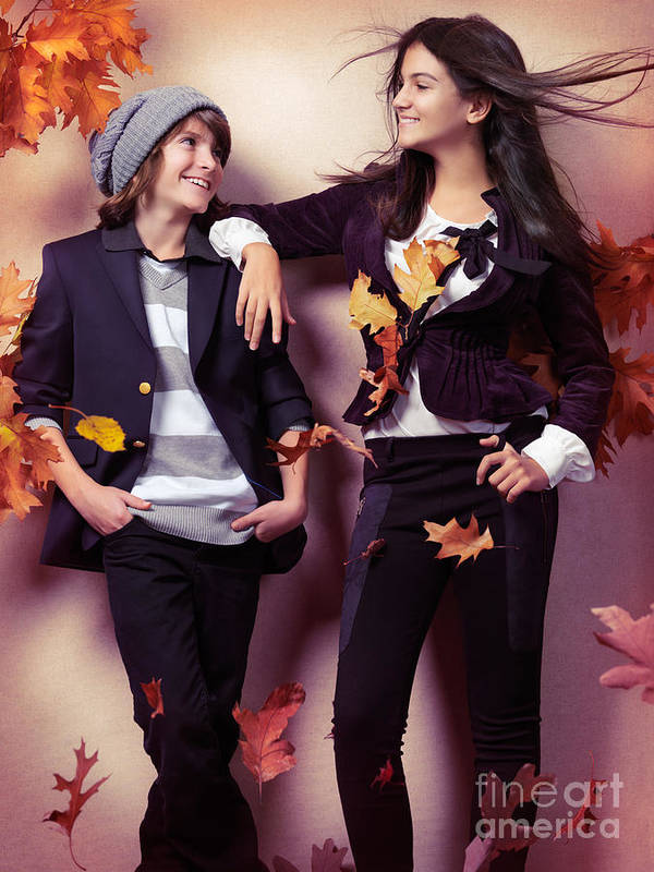 Children Poster featuring the photograph Fashionably Dressed Boy And Teenage Girl Under Falling Autumn Le by Oleksiy Maksymenko