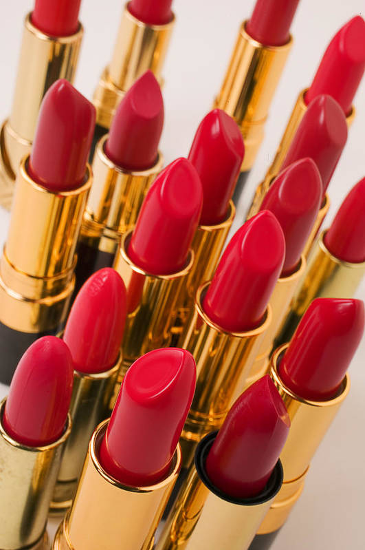 Cosmetics Poster featuring the photograph Group Of Red Lipsticks by Garry Gay