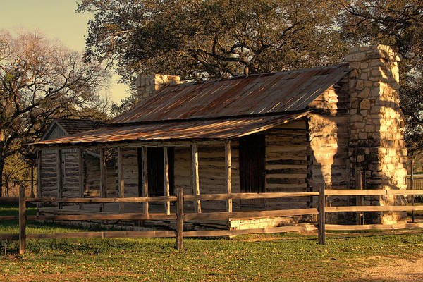 Artitecture Poster featuring the photograph Log Cabins In Sunset by Linda Phelps