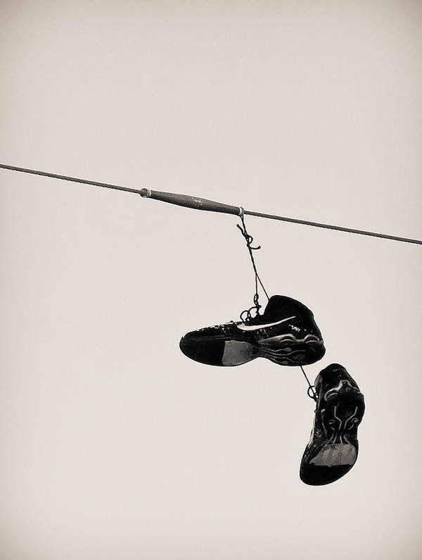 Shoes Poster featuring the photograph Nikes by Tracy Salava