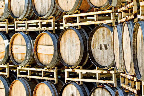 Aging Poster featuring the photograph Rack Of Old Oak Wine Barrels by Susan Schmitz