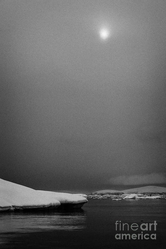 Fournier Poster featuring the photograph sun breaking through mist and cloud over snow covered ice shelf falling into the sea at Fournier Bay by Joe Fox