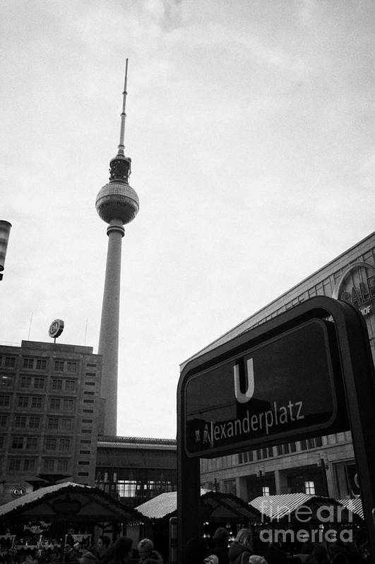 Berlin Poster featuring the photograph the christmas market in Alexanderplatz with the Berlin Fernsehturm and U-bahn sign Germany by Joe Fox