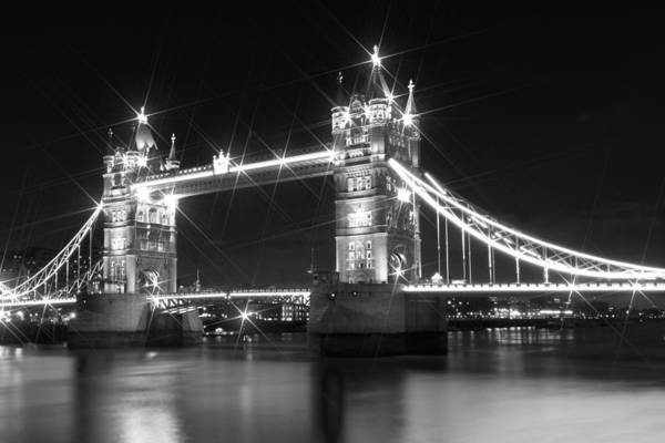British Poster featuring the photograph Tower Bridge By Night - Black And White by Melanie Viola