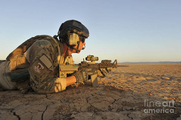 Holding Poster featuring the photograph A Combat Rescue Officer Provides by Stocktrek Images