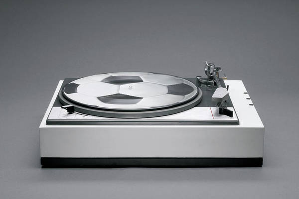 Horizontal Poster featuring the photograph A Disk With A Soccer Print On A Record Player by Benne Ochs