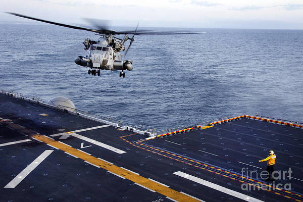 Pacific Ocean Poster featuring the photograph An Mh-53e Sea Dragon Prepares To Land by Stocktrek Images