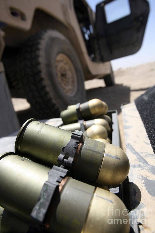 40mm Poster featuring the photograph Cans Of Opened 40 Mm Grenades by Stocktrek Images