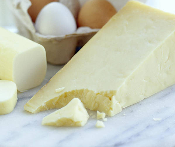 Food Poster featuring the photograph Cheeses And Eggs by David Munns