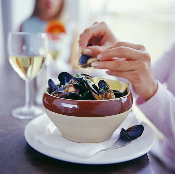 Moules Mariniere Poster featuring the photograph Eating Mussels by David Munns