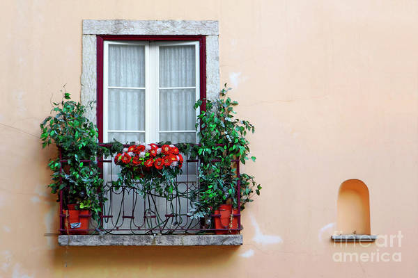 Alfama Poster featuring the photograph Flowery Balcony by Carlos Caetano