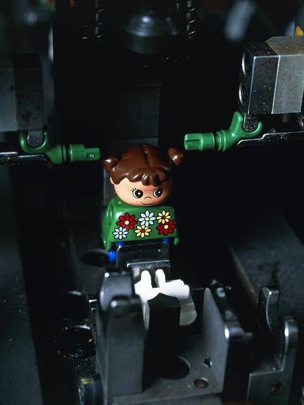 Lego Manufacture Poster featuring the photograph Lego Doll In An Assembly Machine by Volker Steger