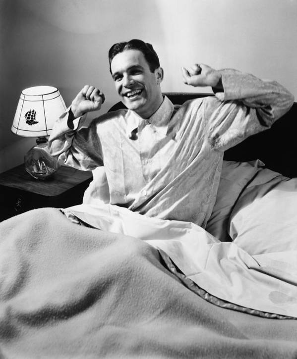 35-39 Years Poster featuring the photograph Man Stretching In Bed, (b&w), by George Marks