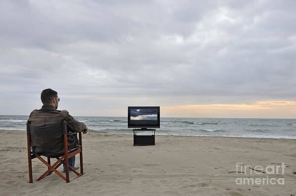 People Poster featuring the photograph Man Watching Tv On Beach At Sunset by Sami Sarkis
