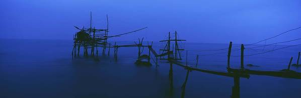 Water Poster featuring the photograph Old Fishing Platform Over Water At Dusk by Axiom Photographic