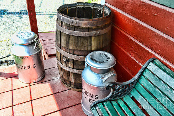 Rain Barrel Poster featuring the photograph Old Milk Cans And Rain Barrel. by Paul Ward