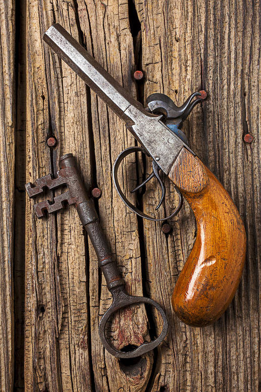 Old Poster featuring the photograph Old Pistol And Skeleton Key by Garry Gay