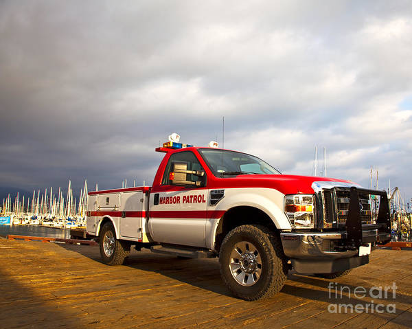 Auto Poster featuring the photograph Red And White Harbor Patrol Vehicle by David Buffington
